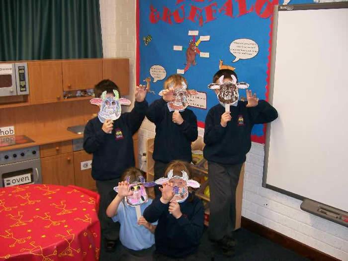 P2 modelling some scary Gruffalo masks.