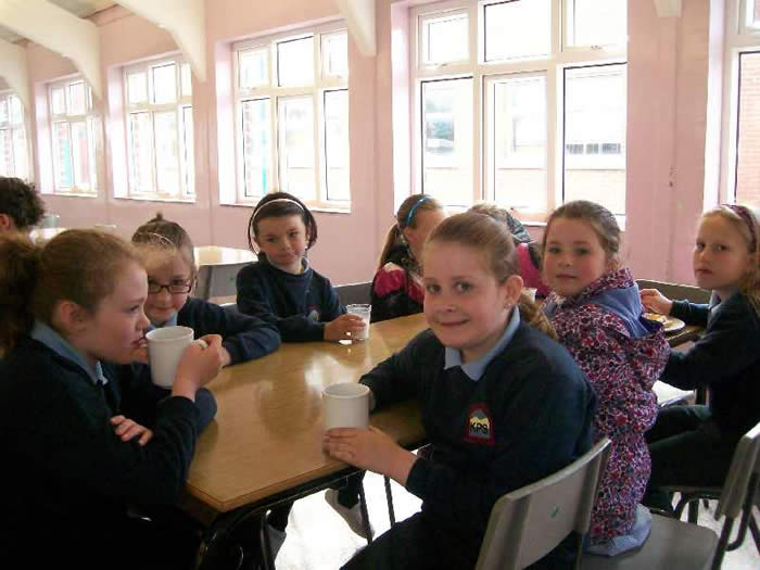 Children enjoying a breakfast in the canteen.